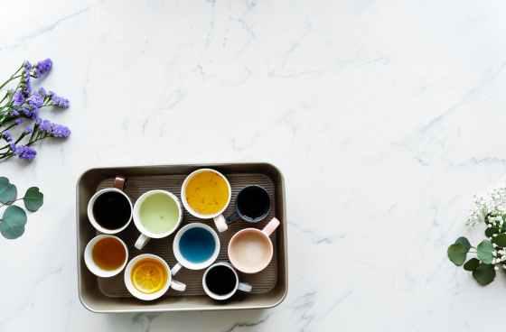 nine white ceramic mugs